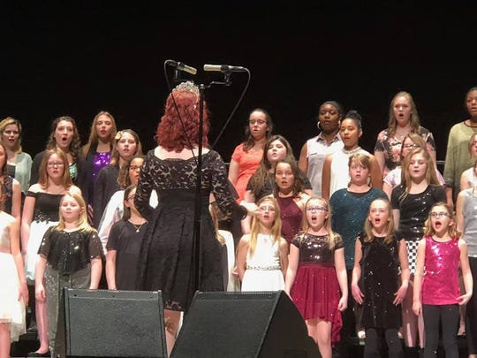 The Young Women in Harmony perform.