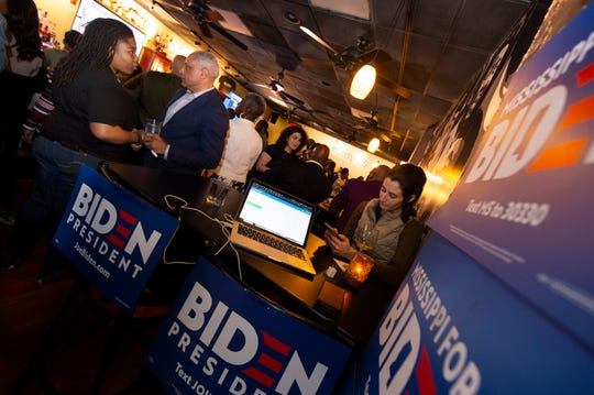 While waiting for returns to come in, Mike Espy talks with Leslyn Smith, left, of Jackson, Miss., during the Joe Biden watch party at Johnny T's in Jackson, Miss., Tuesday, March 10, 2020. Espy went on to win the Mississippi Democratic Senate nomination.