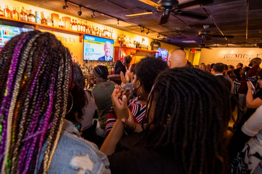 A crowd at a Joe Biden watch party at Johnny T's in Jackson, Miss., erupts in cheers when Biden is named the projected winner in Michigan Tuesday, March 10, 2020. Biden was named the projected winner in Mississippi just minutes after the polls closed.