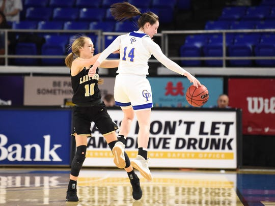 Gatlinburg-Pittman's Shelby Moore (14) steals a pass intended for Upperman's Reagan Hurst (10) in the Division 1 Class AA girls' basketball quarterfinals on Wednesday, March 11, 2020 at Murphy Center in Murfreesboro, TN.