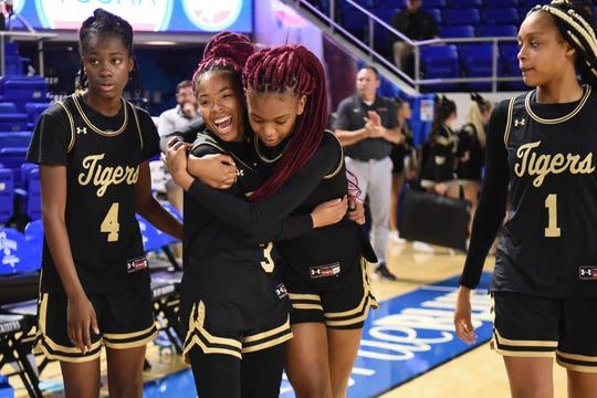 Whitehaven's Se'quoia Allmond (3) and Shelbee Brown (2) celebrate after the win over Maryville in the Division 1 Class AAA girls' basketball quarterfinals on Wednesday, March 11, 2020 at Murphy Center in Murfreesboro, TN. Serena Lee (4) is left and Mya Pratcher (1) at right.