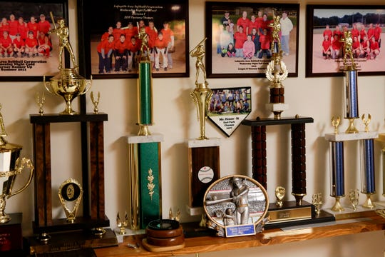 Trophies sit on a wall inside Gene Hurt's house, Tuesday, March 10, 2020 Lafayette.