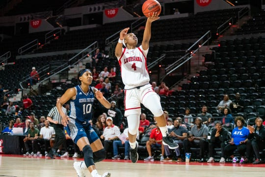 UL's Jomyra Mathis leaps up to the goal to score as the Ragin' Cajuns take on the Georgia Southern Eagles during the opening game of the Sun Belt tournament at the Cajundome on March 3, 2020.