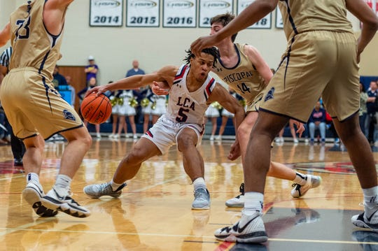 BJ Francis drives to the basket as Lafayette Christian Academy takes on the Episcopal Knights in the semi finals. Tuesday, March 10, 2020.