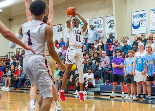 Victor Dupre shoots a three pointer as Lafayette Christian Academy takes on the Episcopal Knights in the semi finals. Tuesday, March 10, 2020.