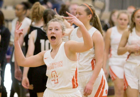 Brighton's Bella Vogt celebrates a regional semifinal basketball victory over Plymouth on Tuesday, March 10, 2020.