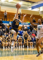 Hartland's Gracey Metz scores two of her seven fourth-quarter points in a 61-52 victory over West Bloomfield in a regional semifinal on Tuesday, March 10, 2020 at Walled Lake Western.
