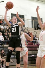 Plymouth's Ainsley Florence shoots and connects, guarded by Brighton's Martha Pietila in the second period of the semifinal game Tuesday, March 10, 2020.