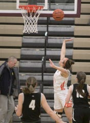Isabelle Viau of Brighton makes this shot in the second period of the regional semifinal game against Plymouth Tuesday, March 10, 2020.