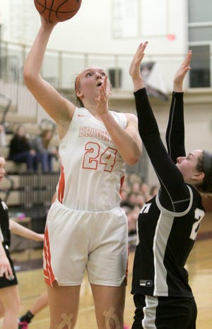Brighton Bulldog Sophie Dziekan, guarded by Kendall LaFlair of Plymouth, makes this shot early in the fourth quarter of the regional semifinal game Tuesday, March 10, 2020.