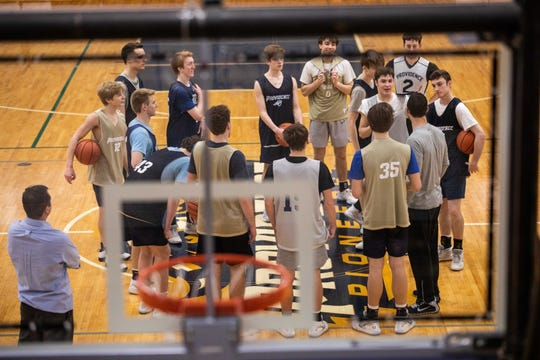 The Providence High School boys basketball team huddles on the court during practice, Tuesday.