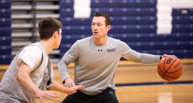 Providence head coach Ryan Miller runs drills during practice, Tuesday in Clarksville, Ind.