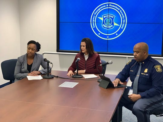 Gov. Gretchen Whitmer, center, joins Michigan Chief Medical Executive Joneigh S. Khaldun, left, and Michigan State Police Captain Emmitt McGowan to announce Michigan's first coronavirus cases on March 10, 2020.