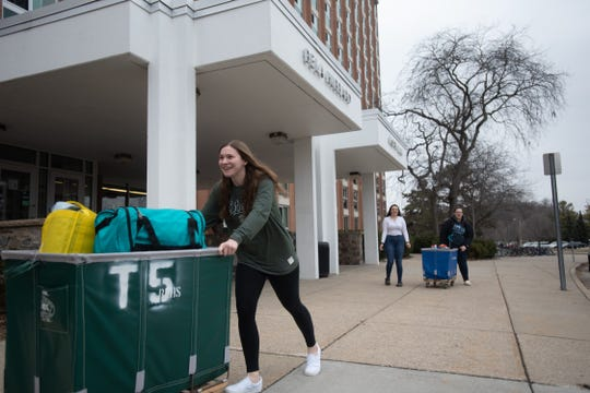 MSU sophomore Shannon Stemaly moves out of Hubbard Hall Wednesday, March 11, 2020 due to Michigan State's decision to suspend in-person classes to limit the risk of the coronavirus.