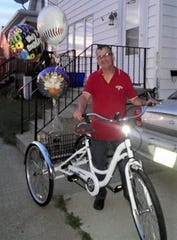 Scotty Paulow, shown here with his three-wheeled bike, which was recently stolen.