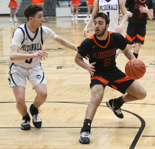 Lucas' Ethan Sauder drives the lane during the Cubs' regional semifinal win over McDonald on March 10. On Thursday, the Cubs had their season canceled due to the COVID-19 coronavirus pandemic.