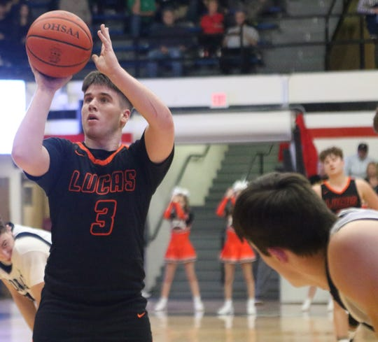 Lucas' Ethan Wallace shoots a free throw during the Cubs' regional semifinal win over McDonald on March 10. On Thursday, the Cubs had their season canceled due to the COVID-19 coronavirus pandemic.