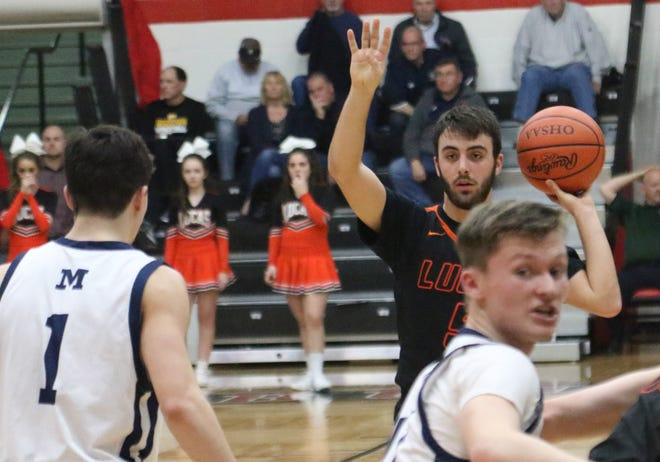 Lucas' Ethan Sauder sets up the Cubs' offense. The Lucas vs. Richmond Heights game on Friday has been postponed along with the state girls basketball, ice hockey, and wrestling tournaments, indefinitely.