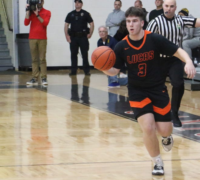 Lucas' Ethan Wallace dribbles down the court during the Cubs' regional semifinal win over McDonald last week. Little did anyone know, it could possibly be the final sporting event in Richland County for the 2019-20 high school athletic season.