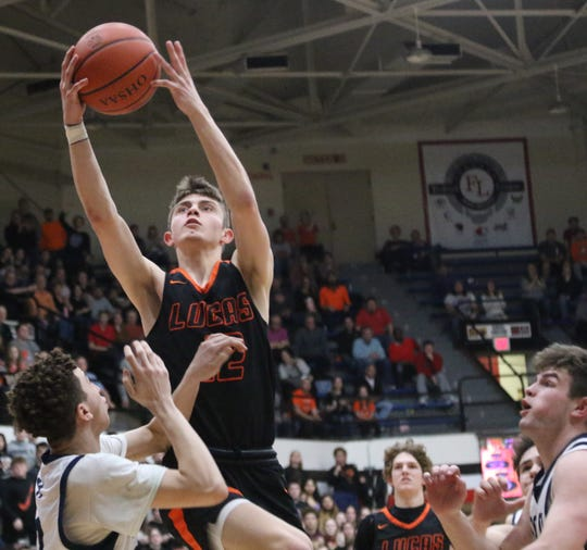 Lucas' Riley Gossom goes up for a layup during the Cubs' regional semifinal win over McDonald on March 10. On Thursday, the Cubs had their season canceled due to the COVID-19 coronavirus pandemic.