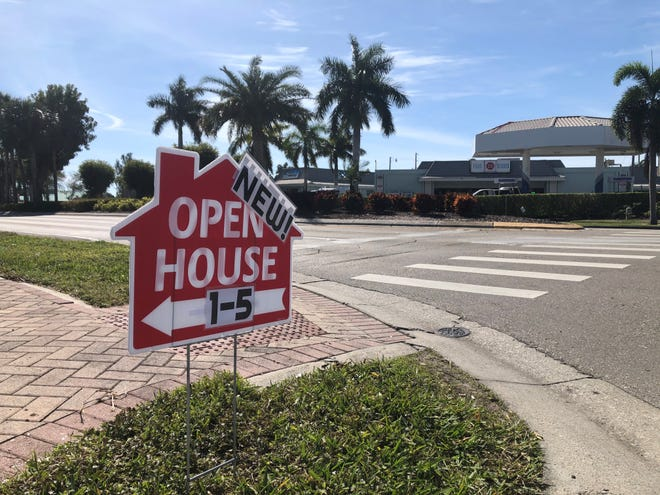 An open house temporary sign is seen at the intersection of N. Barfield Dr. and San Marco Rd. on Feb. 4, 2020.
