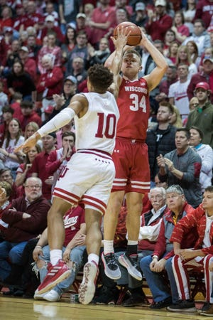 Brad Davison (34) and Wisconsin played its regular-season finale at Indiana in front of a huge crowd. That won't be the case in the NCAA Tournament.