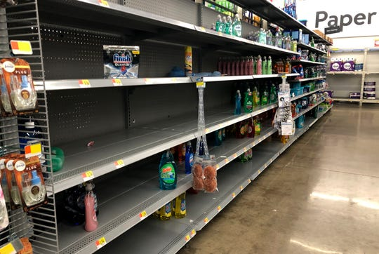 Few bottles of liquid dish soap remained on shelves Tuesday at Walmart, 6701 S. 27th St., Franklin. Customers across the Milwaukee area are stocking up on toilet paper, water bottles and cleaning supplies amid fears they could be isolated in their homes to contain a coronavirus outbreak.