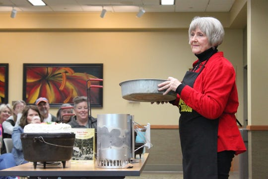 Phyllis Speer prepared a fresh Dutch oven apple cake to share with the crowd attending the Dutch Oven Cooking Seminar at the Baxter County Library last week.