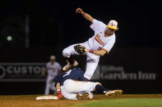University of Louisiana at Monroe's starting pitcher Colby Deaville (32) tags out Ole Miss' Anthony Servideo (3) at second base during the game at Warhawk Field in Monroe, La. on March 10. ULM would fall to Ole Miss 6-3.