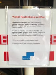 An announcement posted at the entry to Glenwood Regional Medical Center.