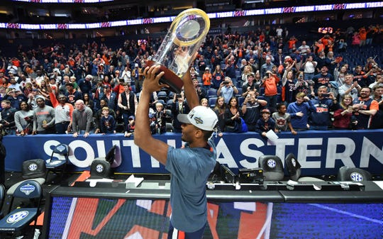 Auburn forward Anfernee McLemore (24) celebrates winning the SEC Championship game at Bridgestone Arena on March 17, 2019, in Nashville, TN.