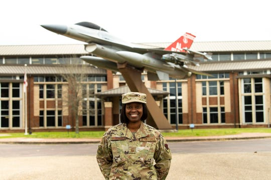 Chief Master Sgt. Bernadette Hollinger, 187th Fighter Wing's command chief, stands in front of the Wing Headquarters building at Dannelly Field, Alabama. Hollinger advises the wing commander, four groups, eleven squadrons and over 1300 enlisted airmen as the senior enlisted member of the wing.