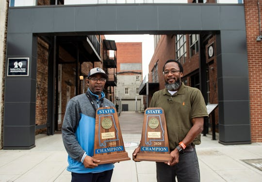 Calhoun coach Ervin Starr and Lee coach Bryant Johnson pose for a picture with their championship trophy  in Montgomery, Ala., on Wednesday, March 11, 2020.