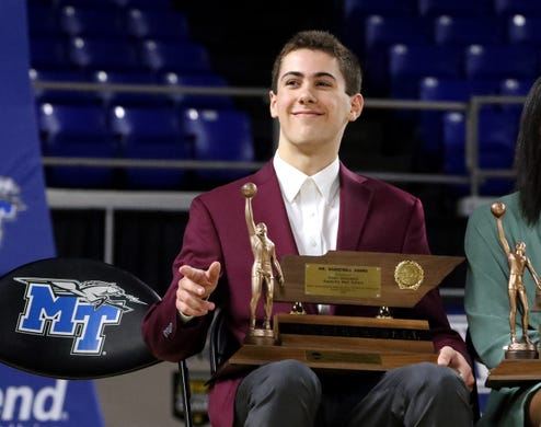 Ryley McClaran, of Eagleville, waves to the crowd after he was presented the Class A Mr. Basketballaward during the 2020 TSSAA Mr. and Miss Basketball awards ceremony on Tuesday, March 10, 2020, at MTSU.