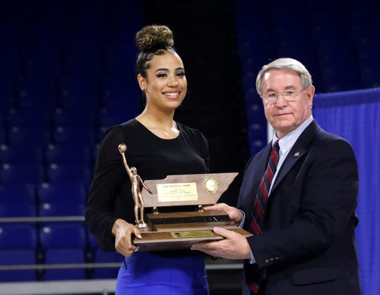 Madison Hayes, of East Hamilton, received the Class AAA Miss Basketballaward from Mike Reed, with the TSSAA Board of Control,  during the 2020 TSSAA Mr. and Miss Basketball awards ceremony on Tuesday, March 10, 2020, at MTSU.