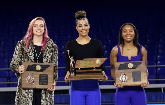 Madison Hayes, center, receives the Class AAA Miss Basketball Award in March 2020.