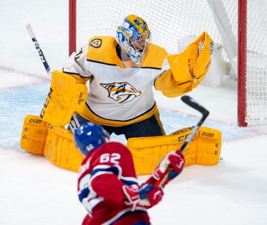 Nashville Predators goaltender Juuse Saros (74) makes a glove save on Montreal Canadiens left wing Artturi Lehkonen (62) during the second period of an NHL hockey game Tuesday, March 10, 2020, in Montreal.