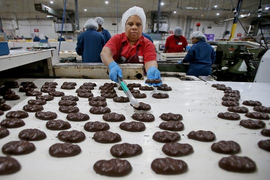 Janice Owens works with Dark Chocolate Heavenly Hash Eggs at the Elmer Chocolate factory in Ponchatoula, Louisiana on Wednesday, February 5, 2020.