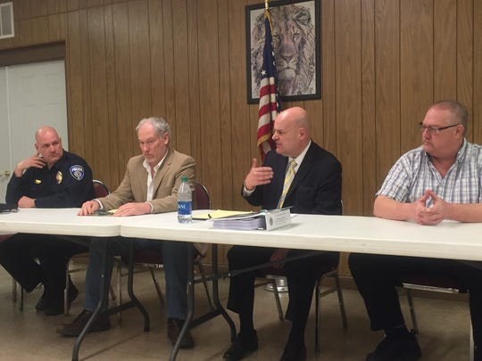 From left, Deputy Chief of Pataskala Police Michael Boals, Mayor Mike Compton, Council President Todd Barstow and former council member Tim Hickin at the March 10 Town Hall.
