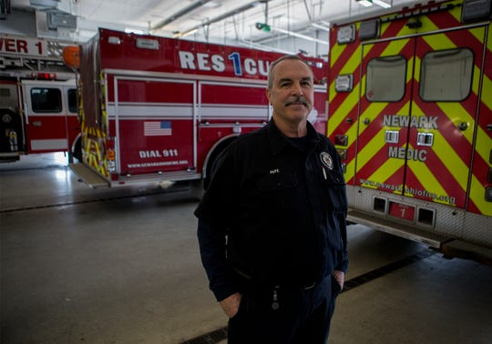 Firefighter Mike Pape retired Monday after 33 years in Newark.