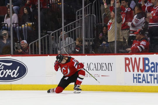 Mar 10, 2020; Newark, New Jersey, USA; New Jersey Devils left wing Nikita Gusev (97) celebrates his goal during the first period of their game against the Pittsburgh Penguins at Prudential Center.