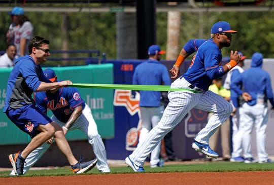 Mar 11, 2020; Port St. Lucie, Florida, USA; New York Mets second baseman Robinson Cano (24) uses a resistance band during warms up in the outfield before a spring training game against the St. Louis Cardinals at Clover Park.
