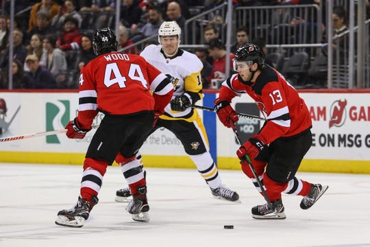 Mar 10, 2020; Newark, New Jersey, USA; New Jersey Devils center Nico Hischier (13) skates with the puck during the first period of their game against the Pittsburgh Penguins at Prudential Center.