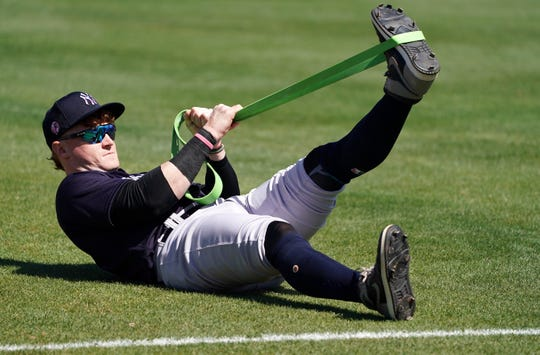 Mar 9, 2020; Clearwater, Florida, USA; New York Yankees left fielder Clint Frazier (77) stretches before their game against the Philadelphia Phillies at Spectrum Field.