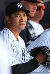 Mar 8, 2020; Tampa, Florida, USA;  New York Yankees starting pitcher Masahiro Tanaka (19) looks on from the dugout against the Atlanta Braves at George M. Steinbrenner Field.