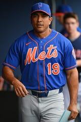Mar 10, 2020; West Palm Beach, Florida, USA;  New York Mets manager Luis Rojas (19) walks through the dugout prior to the spring training game against the Houston Astros at FITTEAM Ballpark of the Palm Beaches.