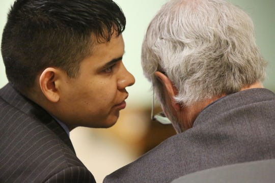 Julio Gutierrez-Barrera consults with his defense attorney Gary Mitchell, in Third Judicial District Court, during his murder trial, Wednesday March 11, 2020.