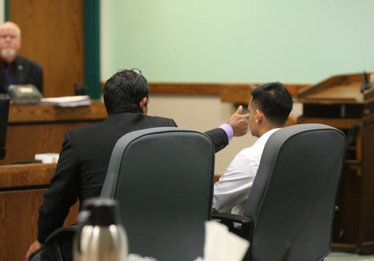 District Attorney Richard Jaquez demonstrates to the court, Tuesday March 10, 2020, how Alonzo Barrera was sitting in the passenger seat of a blue Hyundai Elantra, driven by his brother Julio Gutierrez-Barrera the night of July 29, 2017. Barrera testified that his brother reached past him and fired a gun outside of the car's window.