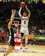 Oñate's Ricky Lujan takes the final shot of the first quarter against Volcano Vista on March 11, 2020 in their 5A quarterfinal game at The Pit in Albuquerque.