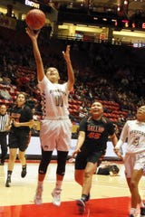 Kirtland Central's Melanie Yazzie gets a fastbreak layup during the first half of their 4A quarterfinals game against Gallup on March 10, 2020 at The Pit in Albuquerque.